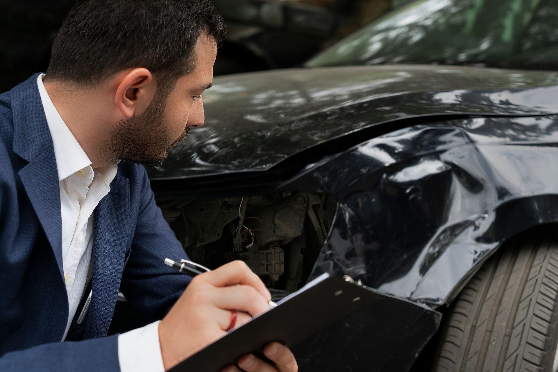 guy checking on black car