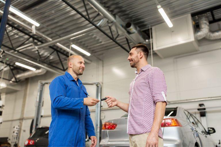2 guys handing out car key
